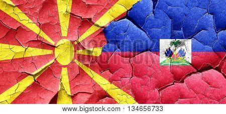 Macedonia flag with Haiti flag on a grunge cracked wall