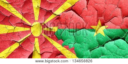 Macedonia flag with Burkina Faso flag on a grunge cracked wall