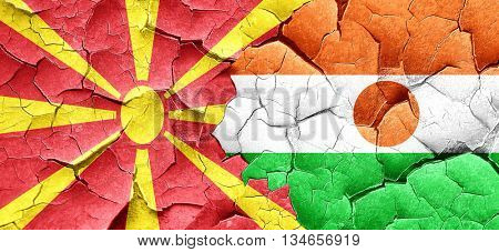 Macedonia flag with Niger flag on a grunge cracked wall