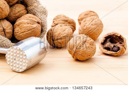 Walnuts Kernels And Whole Walnuts On Wooden Background. Whole And Chopped Walnuts On Wooden Backgrou
