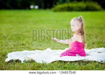 Little Girl With Ladybird In A Park