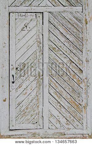 Old grey wood door in a herringbone pattern