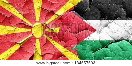 Macedonia flag with Palestine flag on a grunge cracked wall