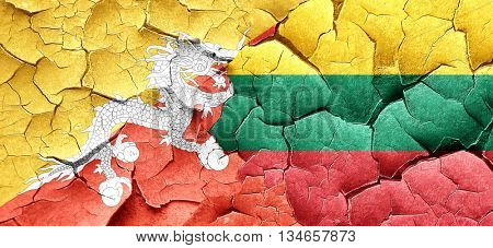 Bhutan flag with Lithuania flag on a grunge cracked wall