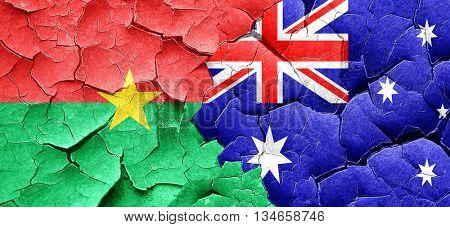Burkina Faso flag with Australia flag on a grunge cracked wall