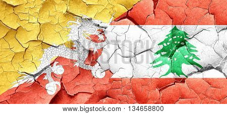 Bhutan flag with Lebanon flag on a grunge cracked wall