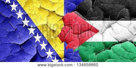 Bosnia and Herzegovina flag with Palestine flag on a grunge crac