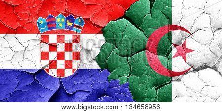 croatia flag with Algeria flag on a grunge cracked wall