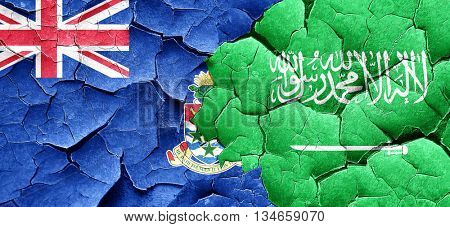cayman islands flag with Saudi Arabia flag on a grunge cracked w