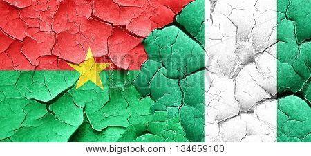Burkina Faso flag with Nigeria flag on a grunge cracked wall