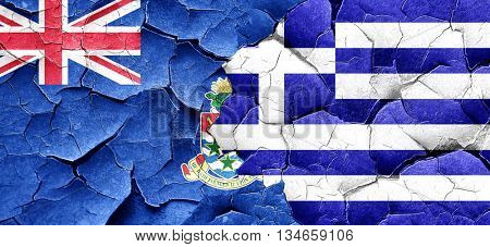 cayman islands flag with Greece flag on a grunge cracked wall