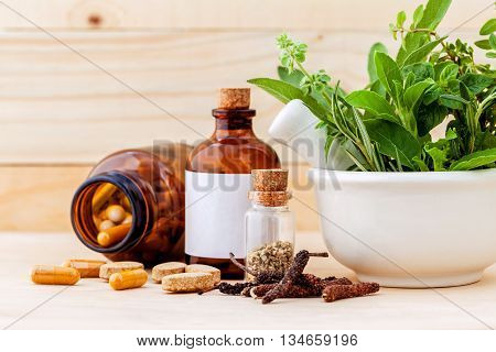 Alternative Health Care Fresh Herbal  ,dry And Herbal Capsule With Mortar On Wooden Background.