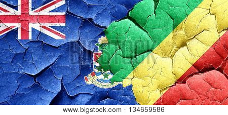 cayman islands flag with congo flag on a grunge cracked wall