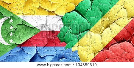 Comoros flag with congo flag on a grunge cracked wall