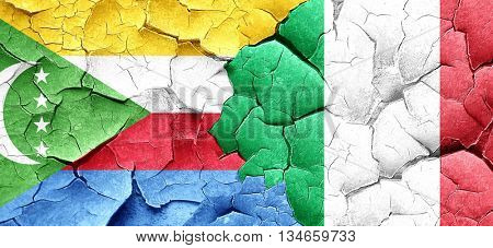 Comoros flag with Italy flag on a grunge cracked wall