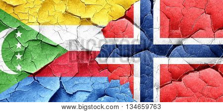 Comoros flag with Norway flag on a grunge cracked wall