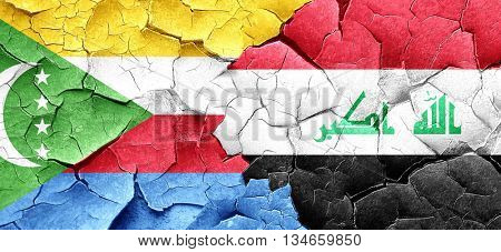 Comoros flag with Iraq flag on a grunge cracked wall