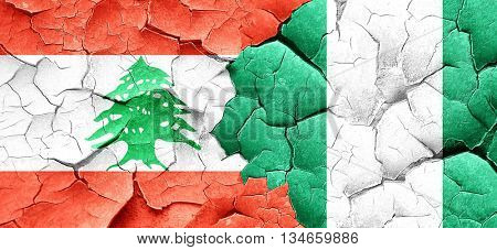 Lebanon flag with Nigeria flag on a grunge cracked wall