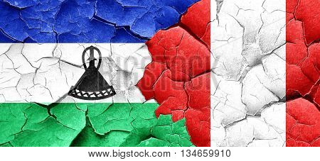 Lesotho flag with Peru flag on a grunge cracked wall