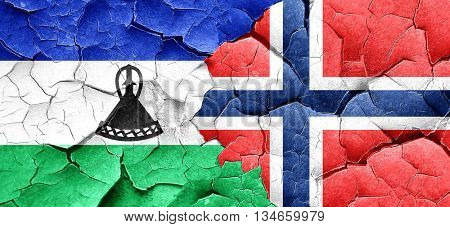 Lesotho flag with Norway flag on a grunge cracked wall