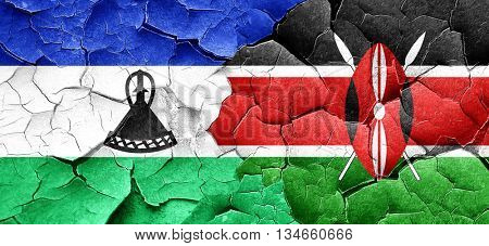 Lesotho flag with Kenya flag on a grunge cracked wall