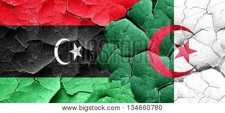 Libya flag with Algeria flag on a grunge cracked wall