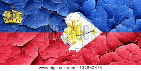 Liechtenstein flag with Philippines flag on a grunge cracked wal