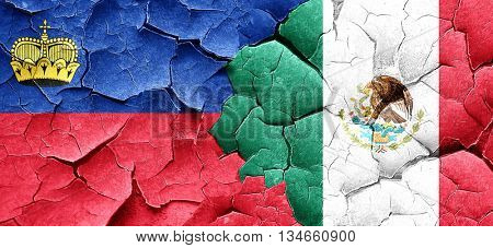 Liechtenstein flag with Mexico flag on a grunge cracked wall