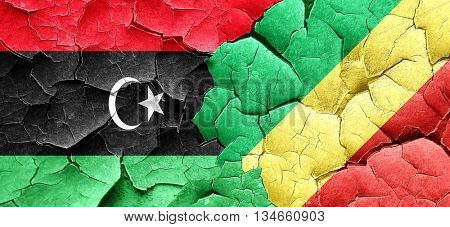 Libya flag with congo flag on a grunge cracked wall