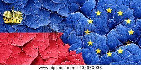 Liechtenstein flag with european union flag on a grunge cracked