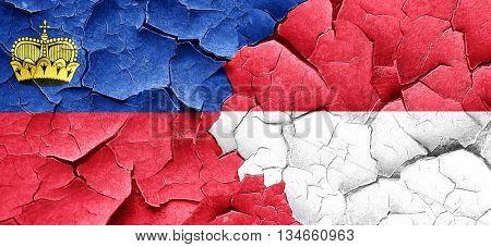 Liechtenstein flag with Indonesia flag on a grunge cracked wall