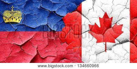 Liechtenstein flag with Canada flag on a grunge cracked wall