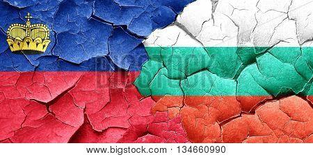 Liechtenstein flag with Bulgaria flag on a grunge cracked wall