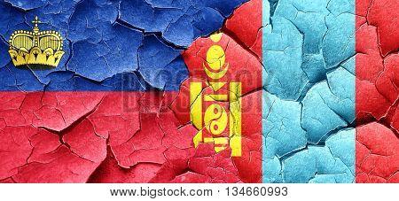 Liechtenstein flag with Mongolia flag on a grunge cracked wall