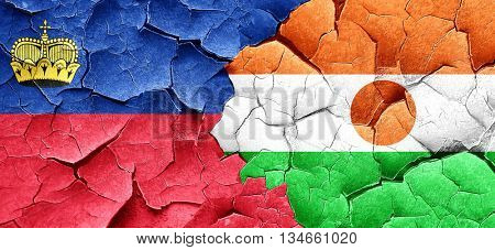 Liechtenstein flag with Niger flag on a grunge cracked wall