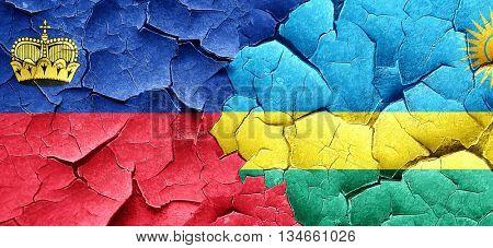 Liechtenstein flag with rwanda flag on a grunge cracked wall