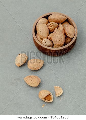 Almonds Kernels And Whole Almonds On Concrete Background. Whole And Chopped Almond On Concrete Backg