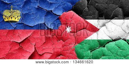 Liechtenstein flag with Jordan flag on a grunge cracked wall