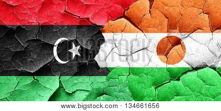 Libya flag with Niger flag on a grunge cracked wall