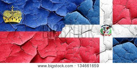 Liechtenstein flag with Dominican Republic flag on a grunge crac