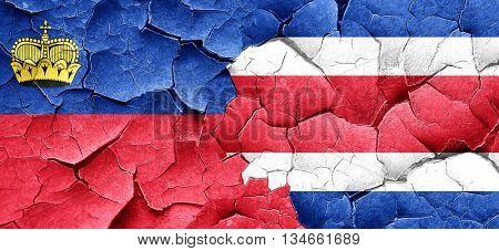 Liechtenstein flag with Costa Rica flag on a grunge cracked wall