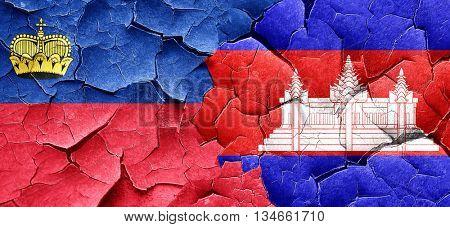 Liechtenstein flag with Cambodia flag on a grunge cracked wall