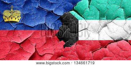 Liechtenstein flag with Kuwait flag on a grunge cracked wall