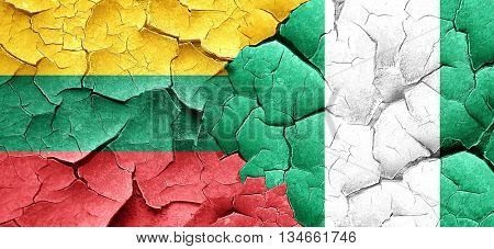 Lithuania flag with Nigeria flag on a grunge cracked wall