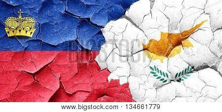 Liechtenstein flag with Cyprus flag on a grunge cracked wall