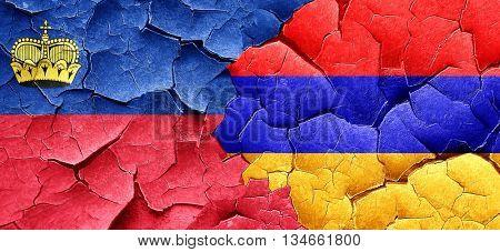 Liechtenstein flag with Armenia flag on a grunge cracked wall
