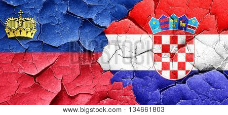 Liechtenstein flag with Croatia flag on a grunge cracked wall