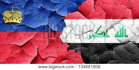 Liechtenstein flag with Iraq flag on a grunge cracked wall