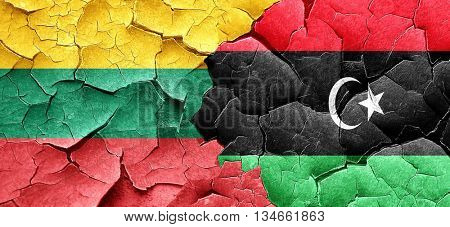 Lithuania flag with Libya flag on a grunge cracked wall