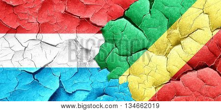 Luxembourg flag with congo flag on a grunge cracked wall
